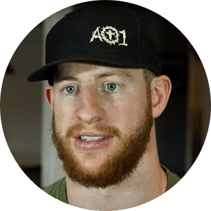 Carson Wentz headshot where the QB is in regular clothes and a black baseball cap.