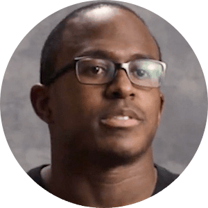 Headshot of Matt Slater talking while wearing glasses.